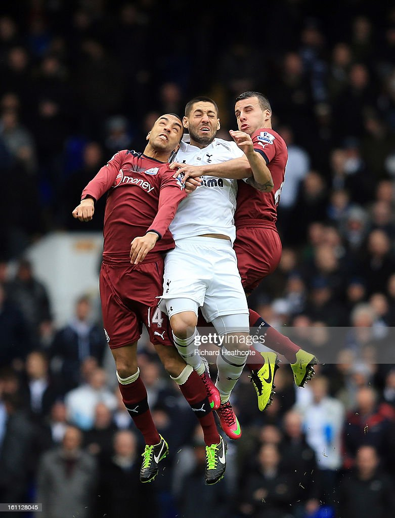 James Perch and Steven Taylor of Newcastle battle with Clint Dempsey of Tottenham for the ball during the Barclay's Premier League match between Tottenham Hotspur and Newcastle United at White Hart Lane on February 9, 2013 in London, England.