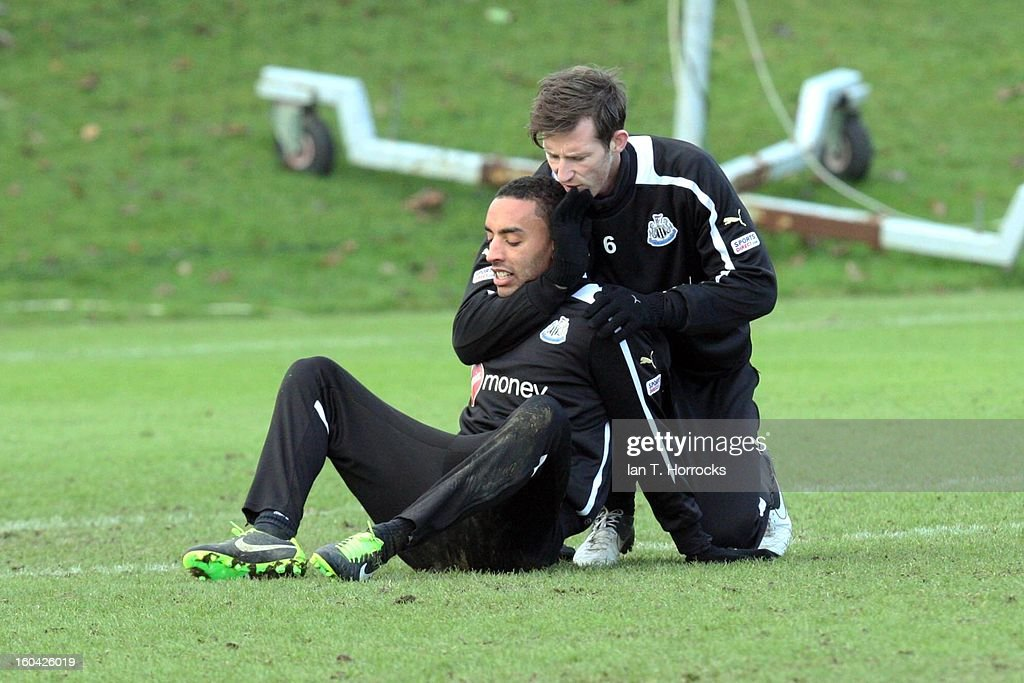 James Perch (left) comes under strong arm tactics from Mike Williamson during a Newcastle United training session at The Little Benton training ground on January 31, 2013 in Birmingham, England.