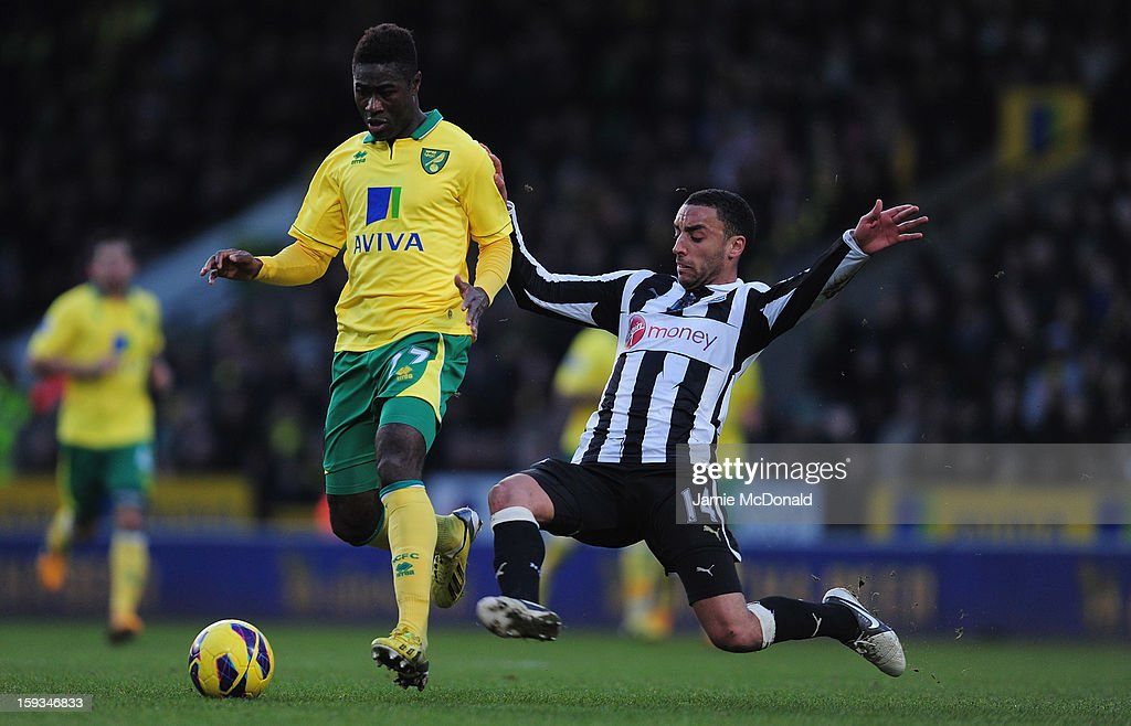 James Perch of Newcastle United battles with Alex Tettey of Norwich City during the Barclays Premier League match between Norwich City and Newcastle United at Carrow Road on January 12, 2013 in Norwich, England.
