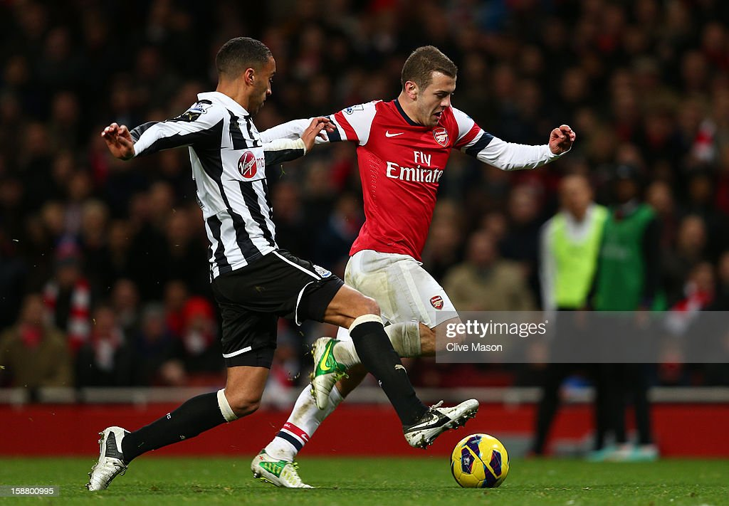 James Perch of Newcastle United tackles Jack Wilshere of Arsenal during the Barclays Premier League match between Arsenal and Newcastle United at the Emirates Stadium on December 29, 2012 in London, England.
