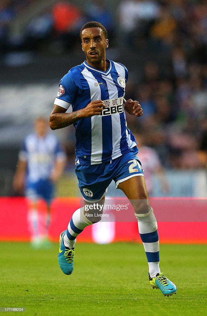 <a gi-track='captionPersonalityLinkClicked' href=/galleries/search?phrase=James+Perch&family=editorial&specificpeople=2211397 ng-click='$event.stopPropagation()'>James Perch</a> of Wigan Athletic during the Sky Bet Championship match between Wigan Athletic and Doncaster Rovers at DW Stadium on August 20, 2013 in Wigan, England,