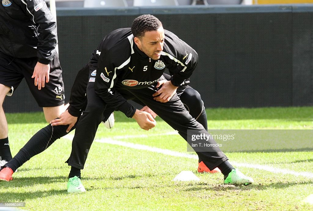 James Perch stretches during a Newcastle United training session at St James' Park on April 19, in Newcastle upon Tyne, England.