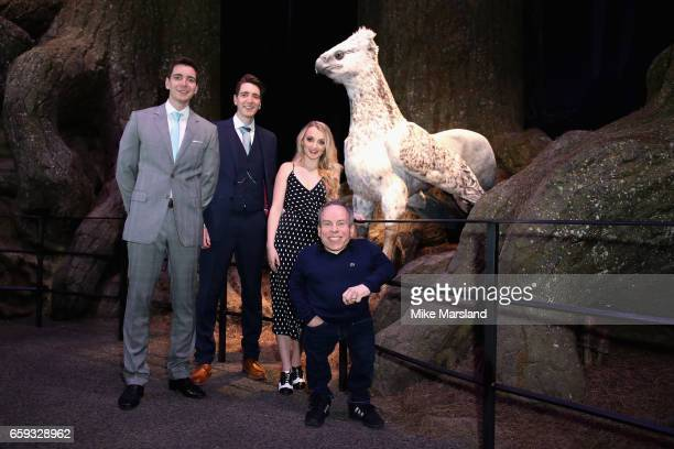 James Phelps Oliver Phelps Evanna Lynch and Warwick Davis come facetoface with Buckbeak the majestic creature in the Forbidden Forest at Warner Bros...
