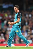 James Pierson of the Heat celebrates dismissing Nick Larkin of the Sixers during the Big Bash League match between the Sydney Sixers and the Brisbane...