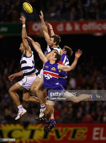 James Podsiadly and Cameron Mooney of the Cats attempt to mark during the round 20 AFL match between the Western Bulldogs and the Geelong Cats at...