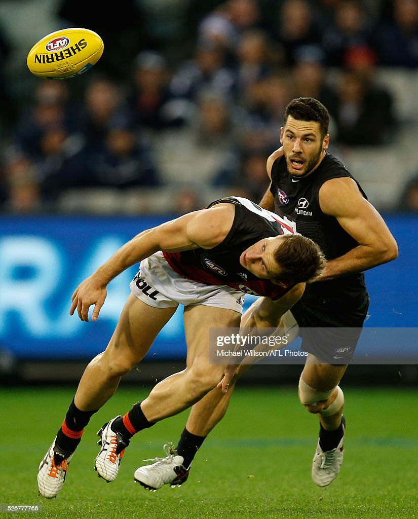 James Polkinghorne of the Bombers and Simon White of the Blues in action during the 2016 AFL Round 06 match between the Carlton Blues and the Essendon Bombers at the Melbourne Cricket Ground, Melbourne on May 1, 2016.