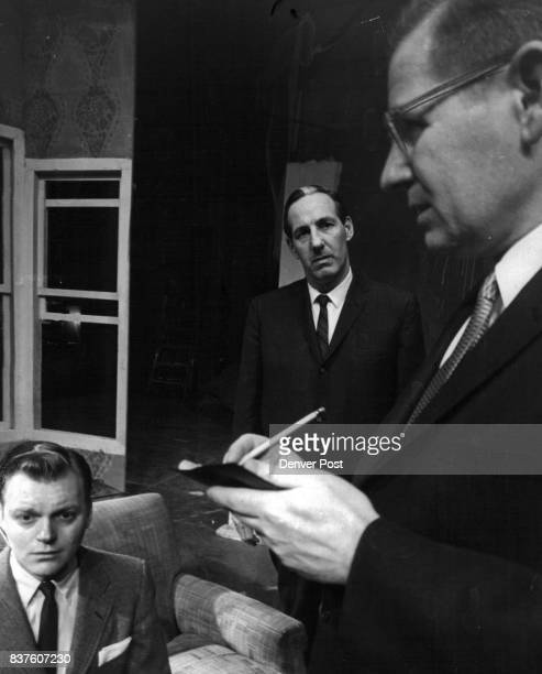 James R Willis right as a Scotland Yord Inspector question Bob Satterlee after the murder of a black mailer in the Civic Theater's 'Not in the Book'...