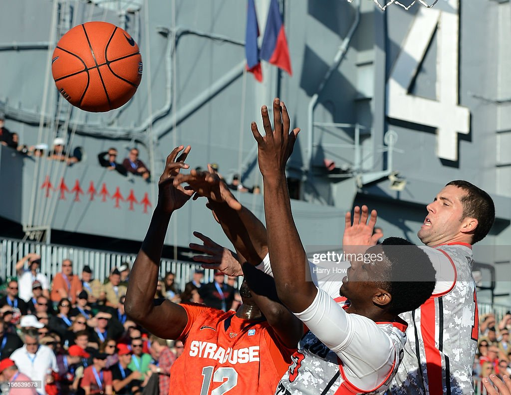 James Rahon #11 and Winston Shepard #13 of the San Diego State Aztecs go for a rebound with Baye Keita #12 of the Syracuse Orange during a 62-49 Syracuse win on the USS Midway on November 11, 2012 in San Diego, California.