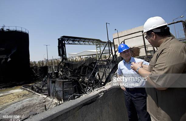 James Rawley United Nations' humanitarian coordinator for the Palestinian territories listens to explanations as he visits a power plant supplying...