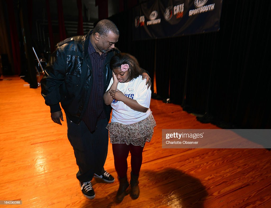 James Raynor, left, hugs his daughter, West Charlotte High School student Jewel Jefferies after she was awarded a $5,000 scholarship on Thursday, March 21, 2013. Bobcats Sports and Entertainment, along with FOX Sports Carolinas/Sports South announced a $200,000 donation to Y Achievers, a YMCA of Greater Charlotte program that operates in partnership with Charlotte-Mecklenburg Schools.