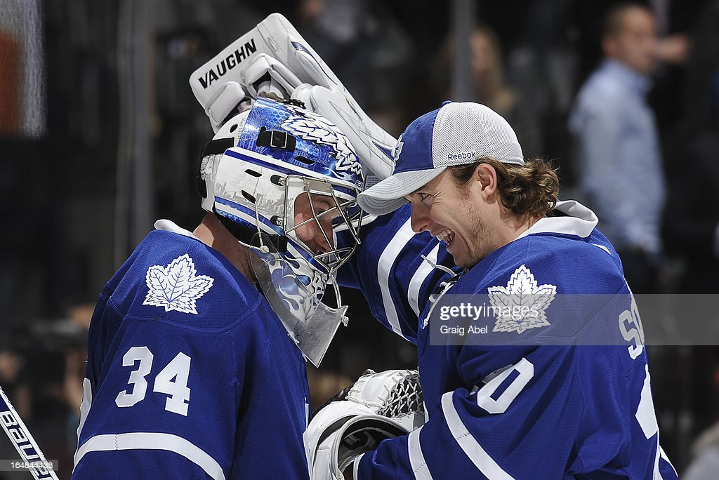 James Reimer #34 and <a gi-track='captionPersonalityLinkClicked' href=/galleries/search?phrase=Ben+Scrivens&family=editorial&specificpeople=7185205 ng-click='$event.stopPropagation()'>Ben Scrivens</a> #30 of the Toronto Maple Leafs celebrate the teams win over the Carolina Hurricanes during NHL game action March 28, 2013 at the Air Canada Centre in Toronto, Ontario, Canada.