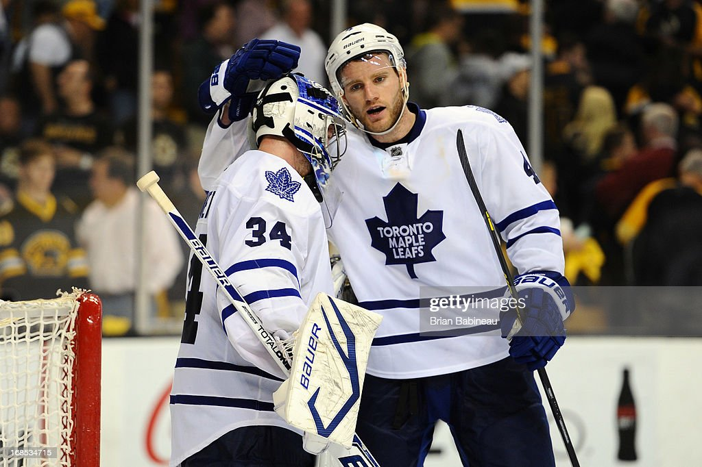 James Reimer #34 and <a gi-track='captionPersonalityLinkClicked' href=/galleries/search?phrase=Cody+Franson&family=editorial&specificpeople=2125769 ng-click='$event.stopPropagation()'>Cody Franson</a> #4 of the Toronto Maple Leafs celebrate a game win against the Boston Bruins in Game Five of the Eastern Conference Quarterfinals during the 2013 NHL Stanley Cup Playoffs at TD Garden on May 10, 2013 in Boston, Massachusetts.