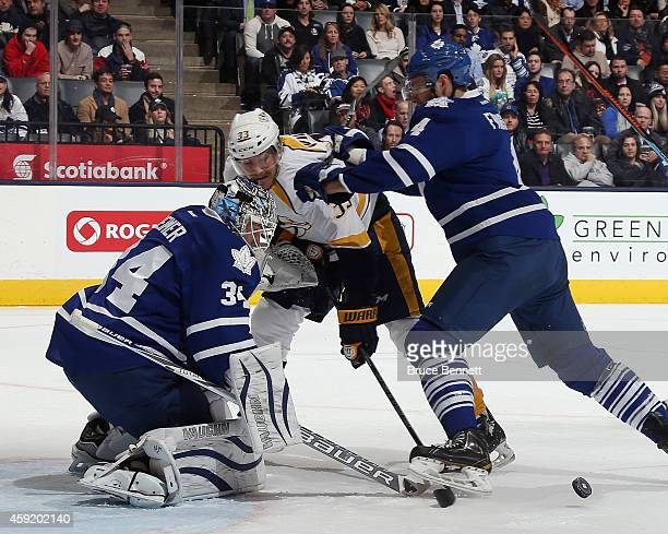 James Reimer and Cody Franson of the Toronto Maple Leafs defend against Colin Wilson of the Nashville Predators during the second period at the Air...