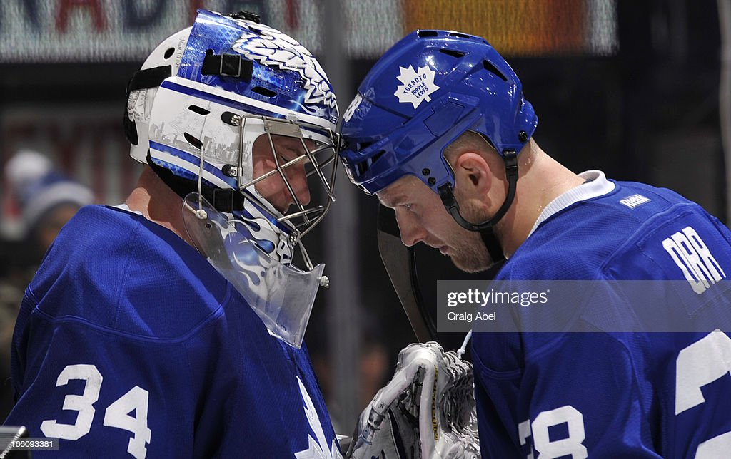 James Reimer #34 and Colton Orr #28 of the Toronto Maple Leafs celebrate the team's win over the New York Rangers during NHL game action April 8, 2013 at the Air Canada Centre in Toronto, Ontario, Canada.