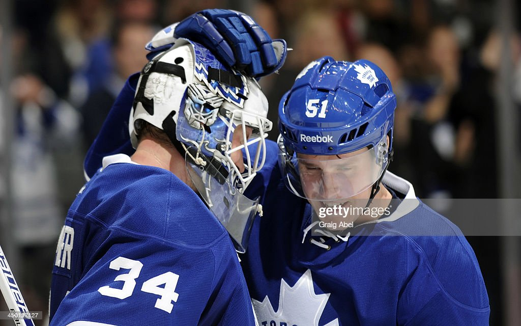 James Reimer #34 and <a gi-track='captionPersonalityLinkClicked' href=/galleries/search?phrase=Jake+Gardiner&family=editorial&specificpeople=4884939 ng-click='$event.stopPropagation()'>Jake Gardiner</a> #51 of the Toronto Maple Leafs celebrate the teams win over the Buffalo Sabres during NHL game action November 16, 2013 at the Air Canada Centre in Toronto, Ontario, Canada.