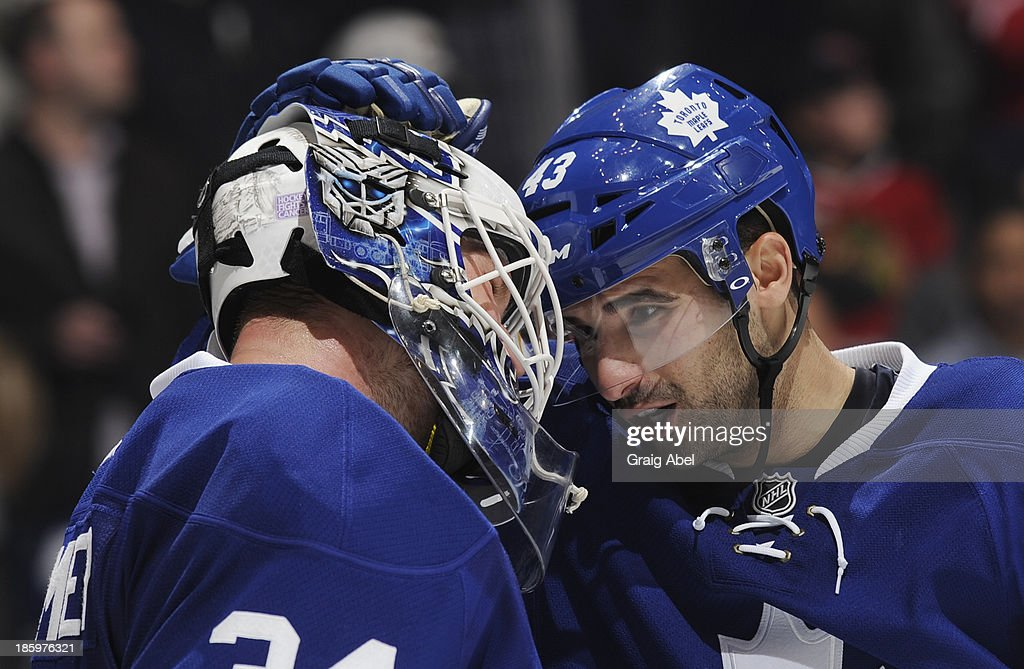 James Reimer #34 and Nazem Kadri #43 of the Toronto Maple Leafs celebrate the team's win over the Pittsburgh Penguins during NHL game action October 26, 2013 at Air Canada Centre in Toronto, Ontario, Canada.