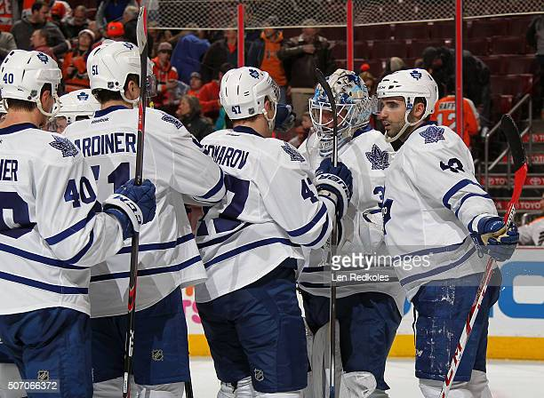 James Reimer Nazem Kadri Leo Komarov Jake Gardiner and Michael Grabner of the Toronto Maple Leafs celebrate after defeating the Philadelphia Flyers...