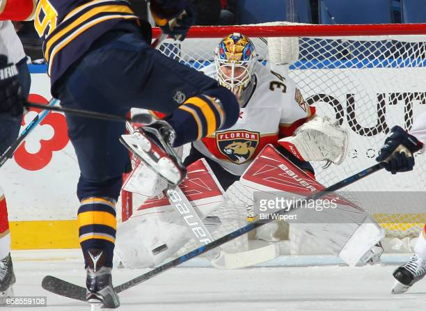 James Reimer of the Florida Panthers looks to make a save on a shot from Evander Kane of the Buffalo Sabres during an NHL game at the KeyBank Center...