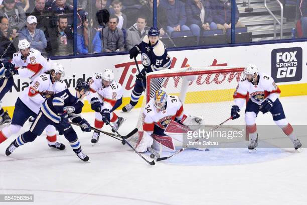 James Reimer of the Florida Panthers makes a save as Aleksander Barkov of the Florida Panthers and Keith Yandle of the Florida Panthers attempt to...