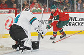 James Reimer of the San Jose Sharks makes a save against Chris Porter of the Minnesota Wild during the game on April 5 2016 at the Xcel Energy Center...