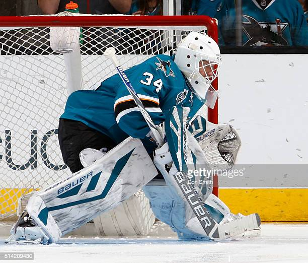 James Reimer of the San Jose Sharks prepares to block a shot against the Vancouver Canucks during a NHL game at the SAP Center at San Jose on March 5...