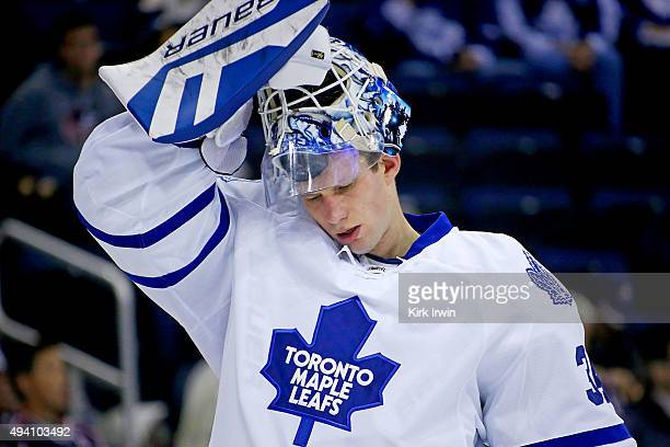 James Reimer of the Toronto Maple Leafs adjusts his mask during a stoppage in play during the game against the Columbus Blue Jackets on October 16...
