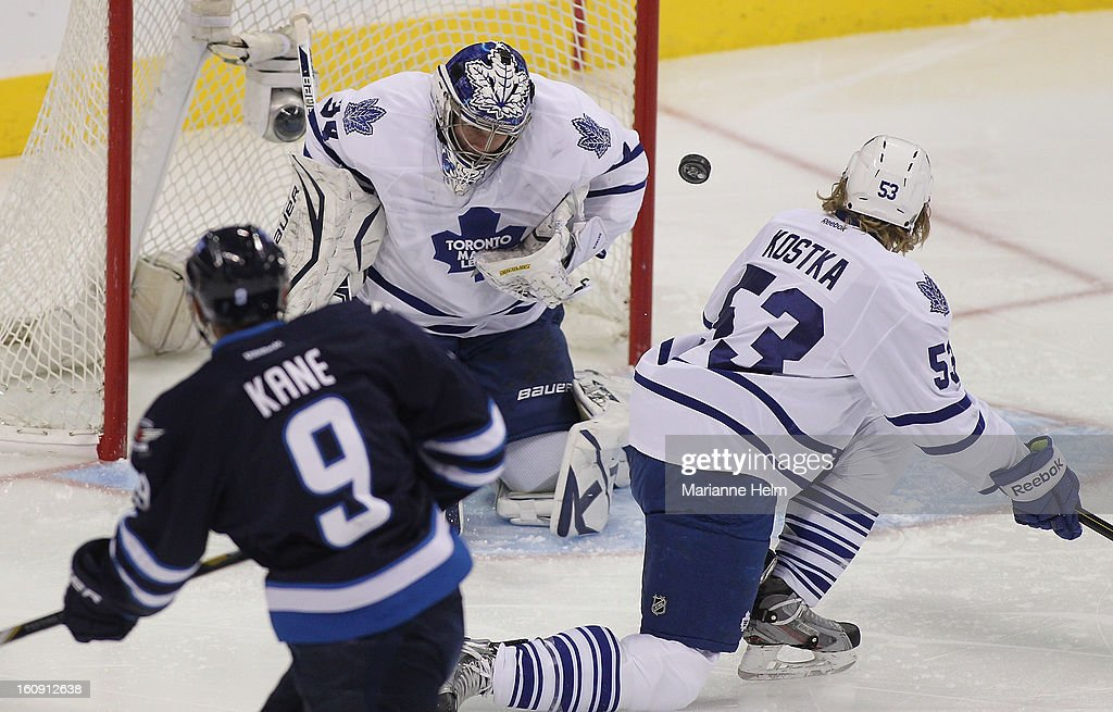 James Reimer #34 of the Toronto Maple Leafs blocks a shot on goal in a game against the Winnipeg Jets during first-period action on February 7, 2013 at the MTS Centre in Winnipeg, Manitoba, Canada.