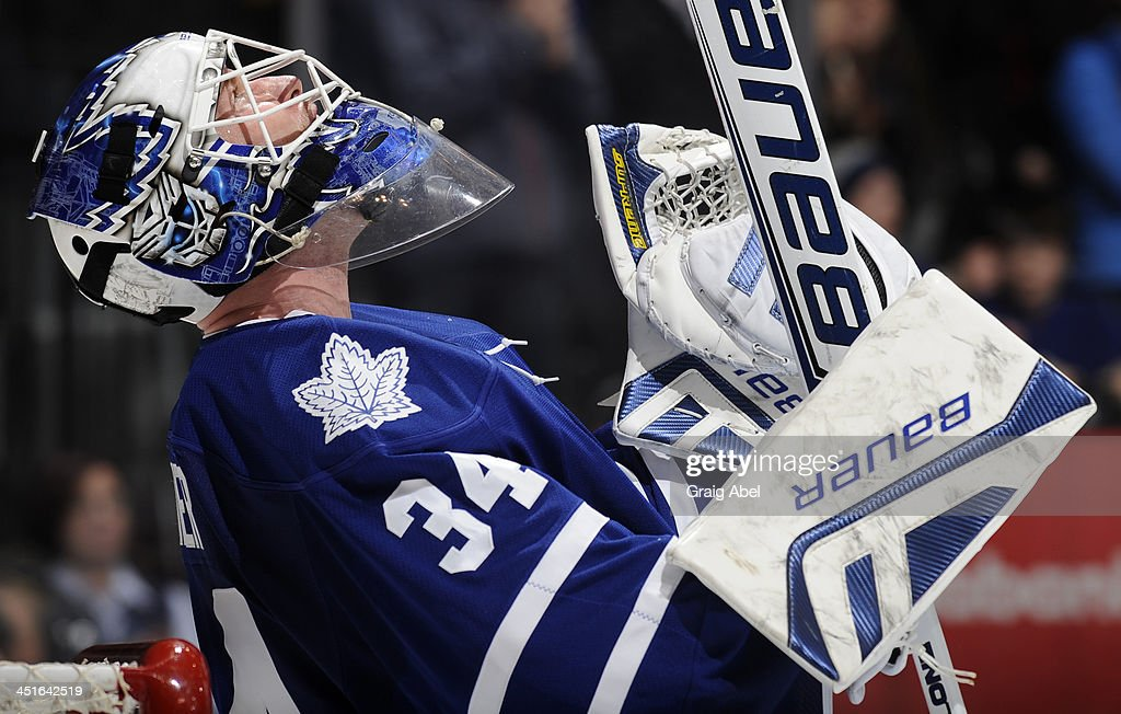 James Reimer #34 of the Toronto Maple Leafs celebrates the teams win over the Washington Capitals during NHL game action November 23, 2013 at the Air Canada Centre in Toronto, Ontario, Canada.