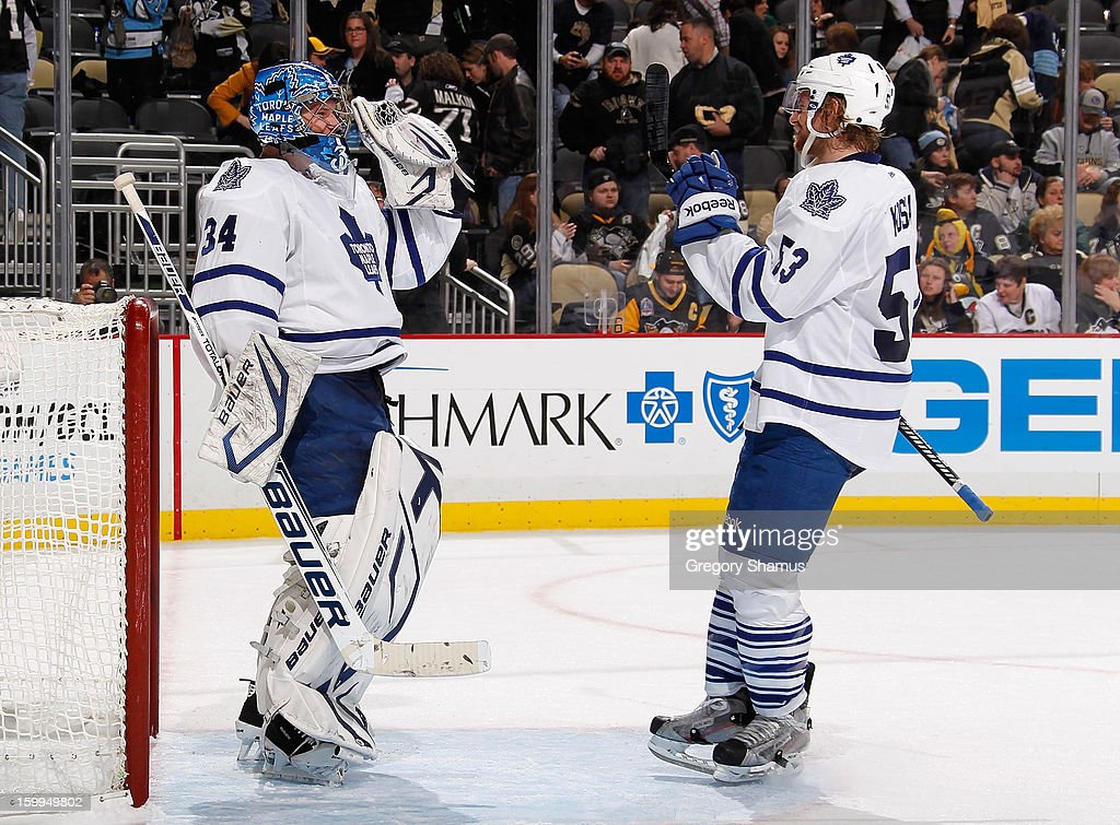 James Reimer #34 of the Toronto Maple Leafs celebrates with Mike Kostka #53 after a 5-2 win over the Pittsburgh Penguins on January 23, 2013 at Consol Energy Center in Pittsburgh, Pennsylvania.