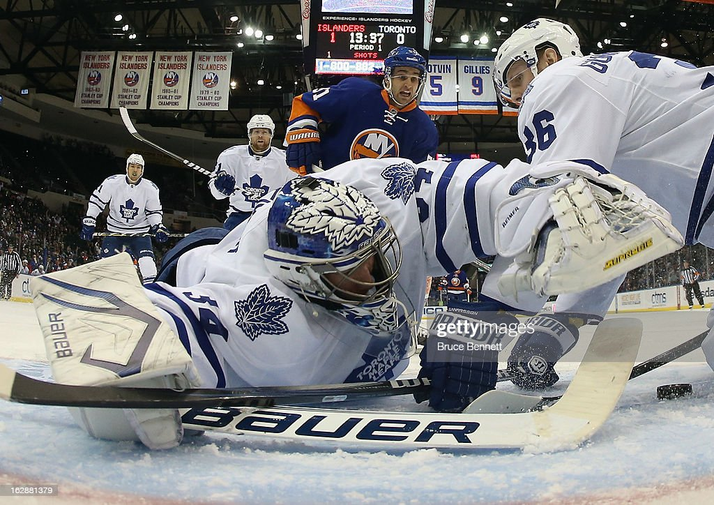 James Reimer #34 of the Toronto Maple Leafs covers the puck in the first period against the New York Islanders at the Nassau Veterans Memorial Coliseum on February 28, 2013 in Uniondale, New York. The Leafs defeated the Islanders 5-4 in overtime.