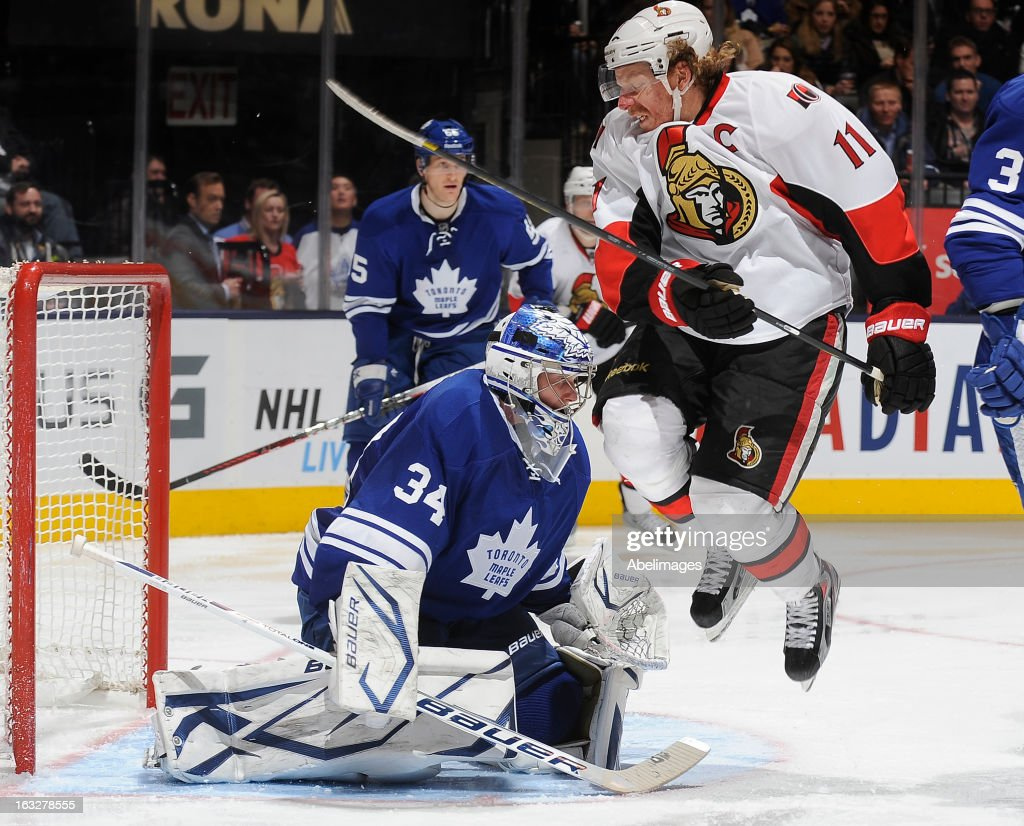 James Reimer #34 of the Toronto Maple Leafs defends the goal as <a gi-track='captionPersonalityLinkClicked' href=/galleries/search?phrase=Daniel+Alfredsson&family=editorial&specificpeople=201853 ng-click='$event.stopPropagation()'>Daniel Alfredsson</a> #11 of the Ottawa Senators jumps through the crease during NHL game action March 6, 2013 at the Air Canada Centre in Toronto, Ontario, Canada.