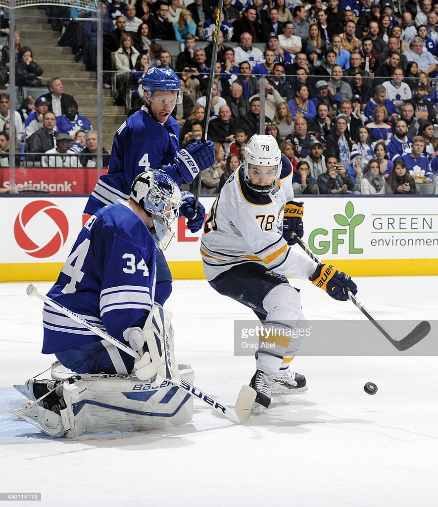 James Reimer #34 of the Toronto Maple Leafs defends the goal as teammate <a gi-track='captionPersonalityLinkClicked' href=/galleries/search?phrase=Cody+Franson&family=editorial&specificpeople=2125769 ng-click='$event.stopPropagation()'>Cody Franson</a> #4 battles for the puck with <a gi-track='captionPersonalityLinkClicked' href=/galleries/search?phrase=Corey+Tropp&family=editorial&specificpeople=5483748 ng-click='$event.stopPropagation()'>Corey Tropp</a> #78 of the Buffalo Sabres during NHL game action November 16, 2013 at the Air Canada Centre in Toronto, Ontario, Canada.