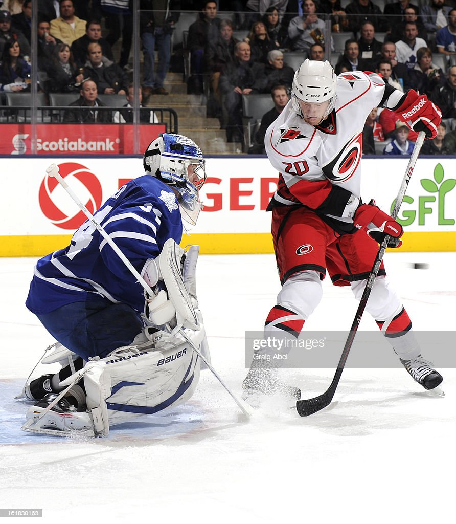 James Reimer #34 of the Toronto Maple Leafs defends the goal with Riley Nash #20 of the Carolina Hurricanes on the doorstep during NHL game action March 28, 2013 at the Air Canada Centre in Toronto, Ontario, Canada.