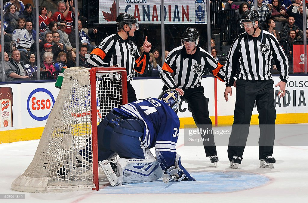 <a gi-track='captionPersonalityLinkClicked' href=/galleries/search?phrase=James+Reimer+-+Hockey+Player&family=editorial&specificpeople=7543302 ng-click='$event.stopPropagation()'>James Reimer</a> #34 of the Toronto Maple Leafs holds onto the puck as referee Brad Watson #23, referee <a gi-track='captionPersonalityLinkClicked' href=/galleries/search?phrase=Kevin+Pollock+-+Ice+Hockey+Referee&family=editorial&specificpeople=4596554 ng-click='$event.stopPropagation()'>Kevin Pollock</a> #33 and linesman Brad Kovachik #71 discus the play during game action on January 23, 2016 at Air Canada Centre in Toronto, Ontario, Canada.