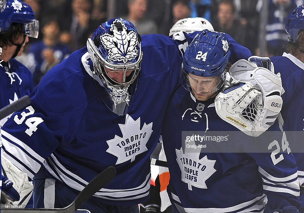 James Reimer #34 of the Toronto Maple Leafs is helped off the ice by teammate <a gi-track='captionPersonalityLinkClicked' href=/galleries/search?phrase=John-Michael+Liles&family=editorial&specificpeople=206866 ng-click='$event.stopPropagation()'>John-Michael Liles</a> #24 during NHL game action against the Philadelphia Flyers February 11, 2013 at the Air Canada Centre in Toronto, Ontario, Canada.