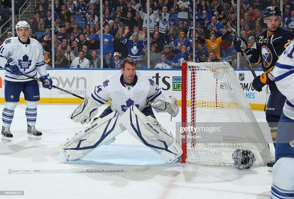 James Reimer #34 of the Toronto Maple Leafs looks for the puck after losing his goaltender's mask alongside teammate <a gi-track='captionPersonalityLinkClicked' href=/galleries/search?phrase=Nikolai+Kulemin&family=editorial&specificpeople=537949 ng-click='$event.stopPropagation()'>Nikolai Kulemin</a> #41 and <a gi-track='captionPersonalityLinkClicked' href=/galleries/search?phrase=Drew+Stafford&family=editorial&specificpeople=220617 ng-click='$event.stopPropagation()'>Drew Stafford</a> #21 of the Buffalo Sabres on March 21, 2013 at the First Niagara Center in Buffalo, New York. Buffalo defeated Toronto, 5-4.