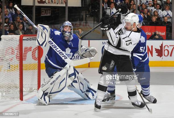 James Reimer of the Toronto Maple Leafs makes a blocker save as teammate Jake Gardiner battles with Brad Richardson of the Los Angeles Kings during...