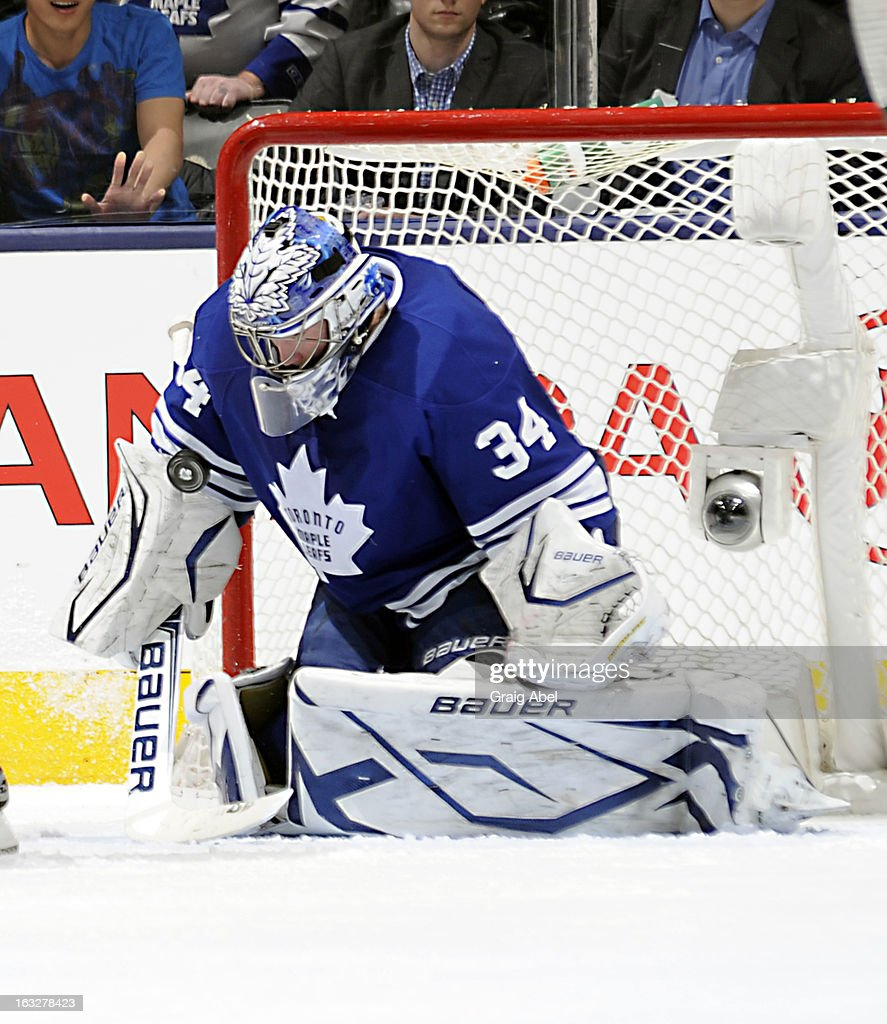 James Reimer #34 of the Toronto Maple Leafs makes a last-second save against the Ottawa Senators during NHL game action March 6, 2013 at the Air Canada Centre in Toronto, Ontario, Canada.