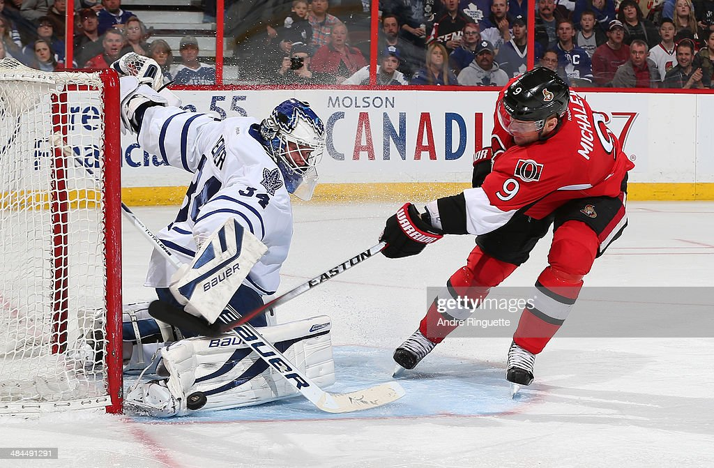 James Reimer #34 of the Toronto Maple Leafs makes a pad save on a breakaway attempt by Milan Michalek #9 of the Ottawa Senators at Canadian Tire Centre on April 12, 2014 in Ottawa, Ontario, Canada.