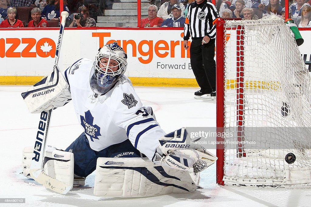 James Reimer #34 of the Toronto Maple Leafs makes a save against the Ottawa Senators on April 12, 2014 at Canadian Tire Centre in Ottawa, Ontario, Canada.