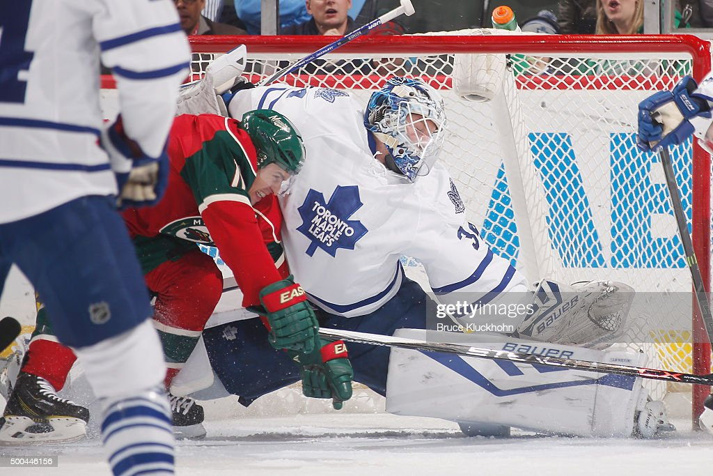 <a gi-track='captionPersonalityLinkClicked' href=/galleries/search?phrase=James+Reimer+-+Hockey+Player&family=editorial&specificpeople=7543302 ng-click='$event.stopPropagation()'>James Reimer</a> #34 of the Toronto Maple Leafs makes a save against <a gi-track='captionPersonalityLinkClicked' href=/galleries/search?phrase=Zach+Parise&family=editorial&specificpeople=213606 ng-click='$event.stopPropagation()'>Zach Parise</a> #11 of the Minnesota Wild during the game on December 3, 2015 at the Xcel Energy Center in St. Paul, Minnesota.