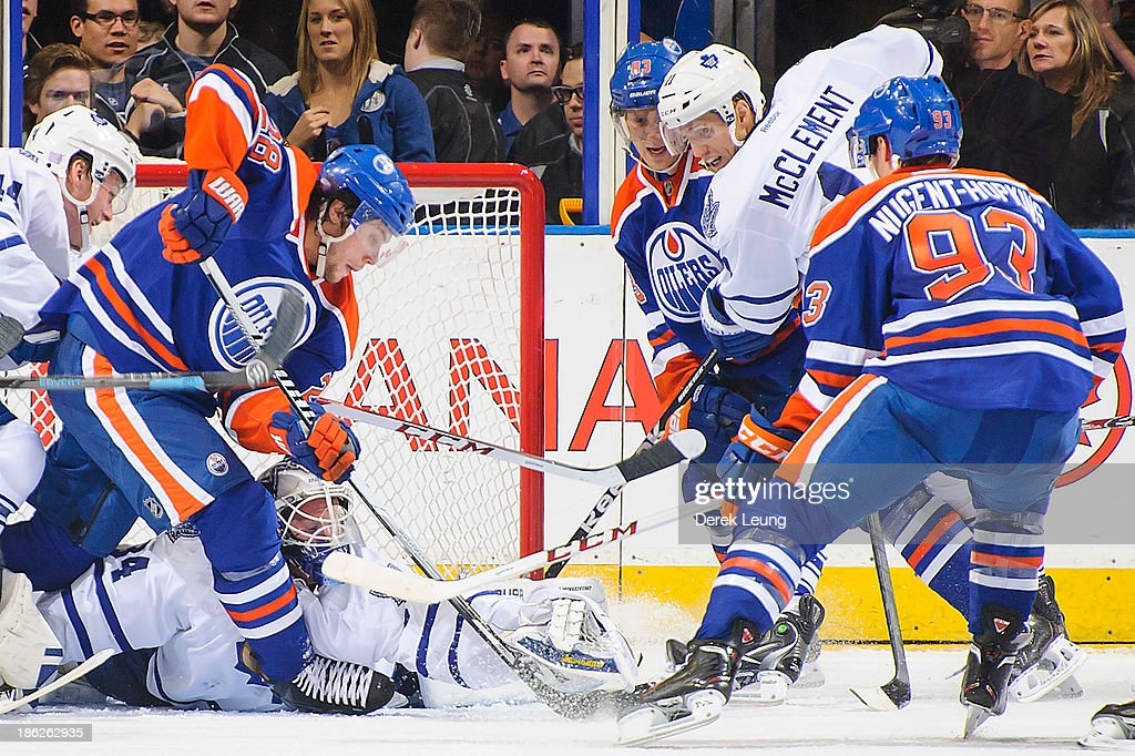 James Reimer #34 of the Toronto Maple Leafs makes a save in front of <a gi-track='captionPersonalityLinkClicked' href=/galleries/search?phrase=Ryan+Nugent-Hopkins&family=editorial&specificpeople=7144190 ng-click='$event.stopPropagation()'>Ryan Nugent-Hopkins</a> #93 and Ryan Jones #28 of the Edmonton Oilers during an NHL game on October, 29, 2013 at Rexall Place in Edmonton, AB, Canada.