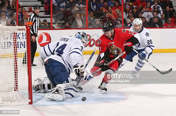 James Reimer of the Toronto Maple Leafs makes a save on a scoring chance by Curtis Lazar of the Ottawa Senators at Canadian Tire Centre on January 21...