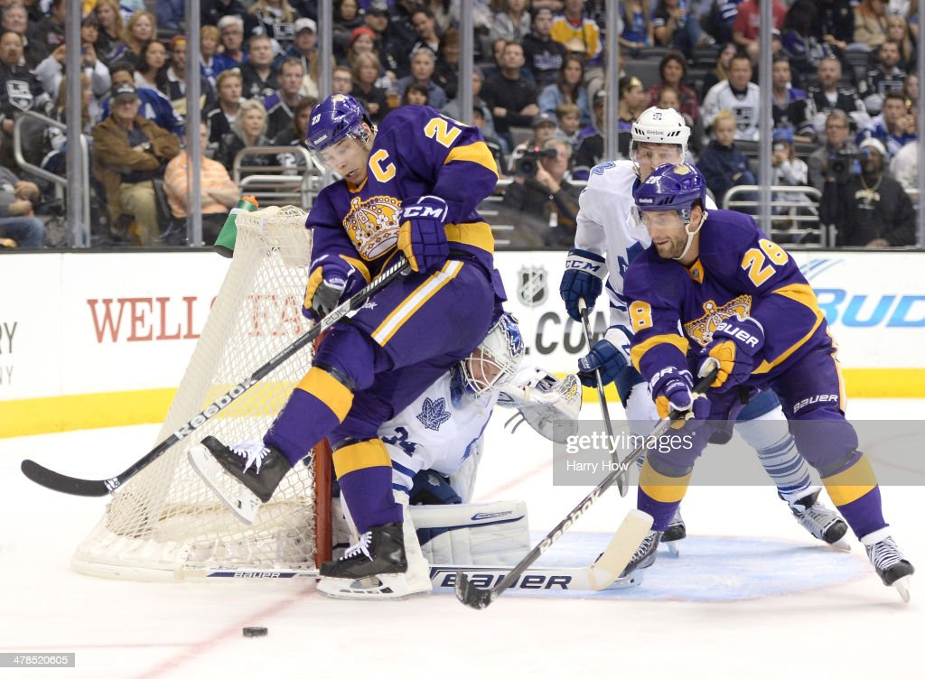 James Reimer #34 of the Toronto Maple Leafs makes a save on Dustin Brown #23 of the Los Angeles Kings as <a gi-track='captionPersonalityLinkClicked' href=/galleries/search?phrase=Jarret+Stoll&family=editorial&specificpeople=204632 ng-click='$event.stopPropagation()'>Jarret Stoll</a> #28 and <a gi-track='captionPersonalityLinkClicked' href=/galleries/search?phrase=Jake+Gardiner&family=editorial&specificpeople=4884939 ng-click='$event.stopPropagation()'>Jake Gardiner</a> #51 look for a rebound during the second period against the Los Angeles Kings at Staples Center on March 13, 2014 in Los Angeles, California.