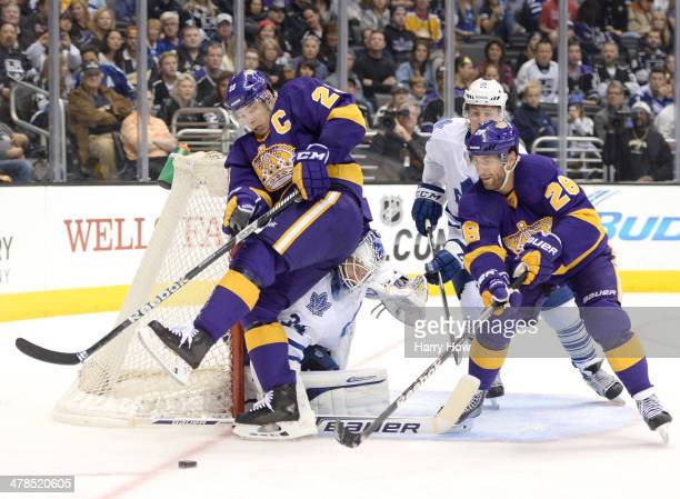 James Reimer of the Toronto Maple Leafs makes a save on Dustin Brown of the Los Angeles Kings as Jarret Stoll and Jake Gardiner look for a rebound...