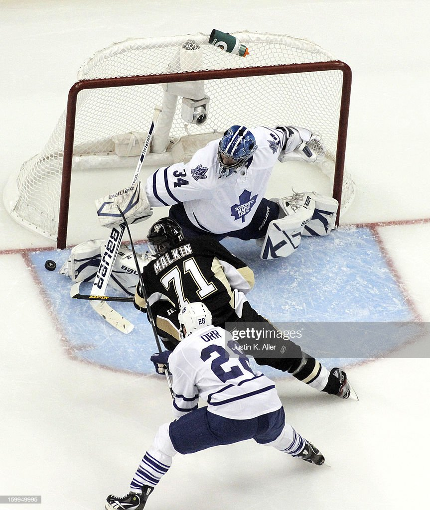 James Reimer #34 of the Toronto Maple Leafs makes a save on <a gi-track='captionPersonalityLinkClicked' href=/galleries/search?phrase=Evgeni+Malkin&family=editorial&specificpeople=221676 ng-click='$event.stopPropagation()'>Evgeni Malkin</a> #71 of the Pittsburgh Penguins during the game at Consol Energy Center on January 23, 2013 in Pittsburgh, Pennsylvania. The Leafs defeated the Pens 5-2.