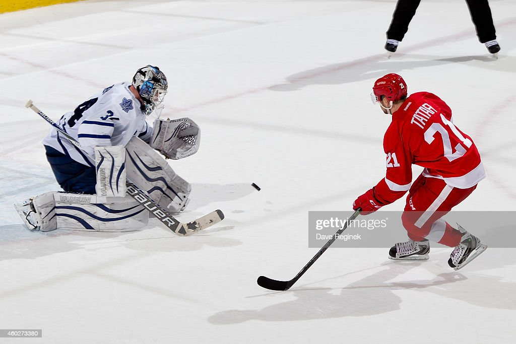 <a gi-track='captionPersonalityLinkClicked' href=/galleries/search?phrase=James+Reimer+-+Hockey+Player&family=editorial&specificpeople=7543302 ng-click='$event.stopPropagation()'>James Reimer</a> #34 of the Toronto Maple Leafs makes a save on <a gi-track='captionPersonalityLinkClicked' href=/galleries/search?phrase=Tomas+Tatar&family=editorial&specificpeople=5652303 ng-click='$event.stopPropagation()'>Tomas Tatar</a> #21 of the Detroit Red Wings during a shootout in a NHL game on December 10, 2014 at Joe Louis Arena in Detroit, Michigan. The Maple Leafs defeated the wings 2-1 in a shootout.