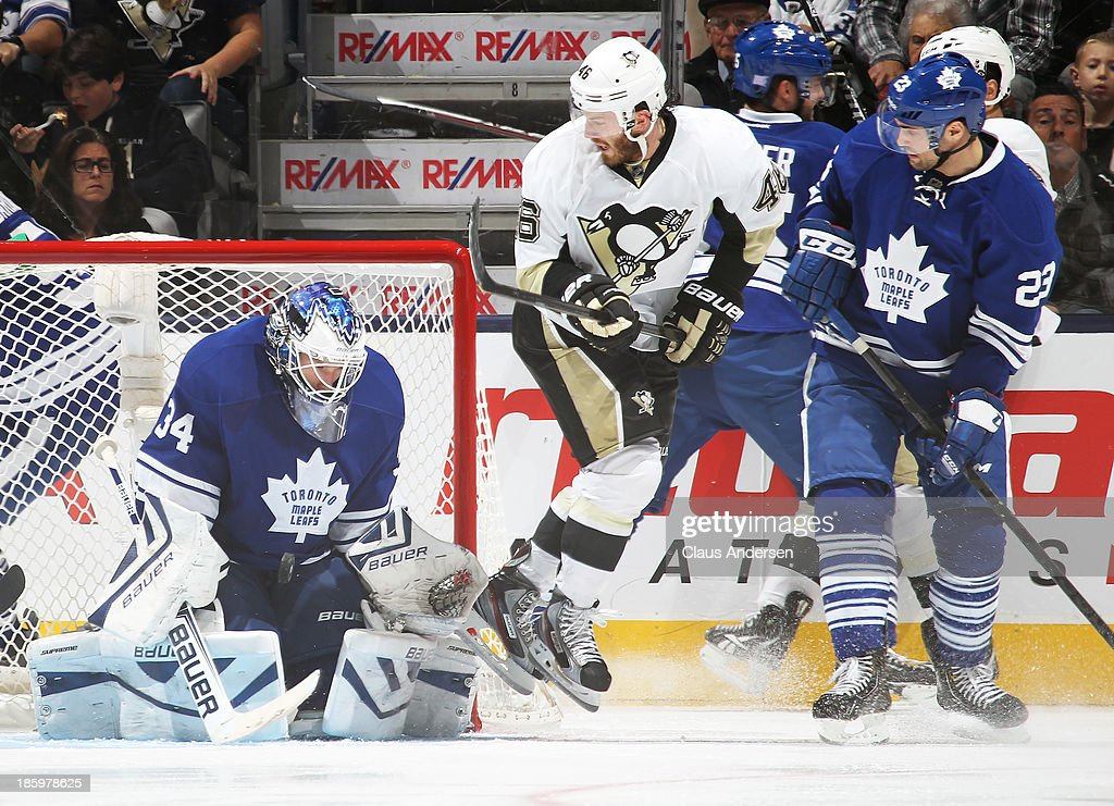 James Reimer #34 of the Toronto Maple Leafs makes a stop against the Pittsburgh Penguins during an NHL game at the Air Canada Centre on October 26, 2013 in Toronto, Ontario, Canada. The Leafs defeated the Penguins 4-1.