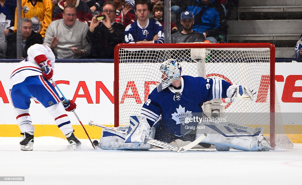 <a gi-track='captionPersonalityLinkClicked' href=/galleries/search?phrase=James+Reimer+-+Joueur+de+hockey&family=editorial&specificpeople=7543302 ng-click='$event.stopPropagation()'>James Reimer</a> #34 of the Toronto Maple Leafs makes a toe save on <a gi-track='captionPersonalityLinkClicked' href=/galleries/search?phrase=David+Desharnais&family=editorial&specificpeople=4084305 ng-click='$event.stopPropagation()'>David Desharnais</a> #51 of the Montreal Canadiens during NHL game action January 23, 2016 at Air Canada Centre in Toronto, Ontario, Canada.