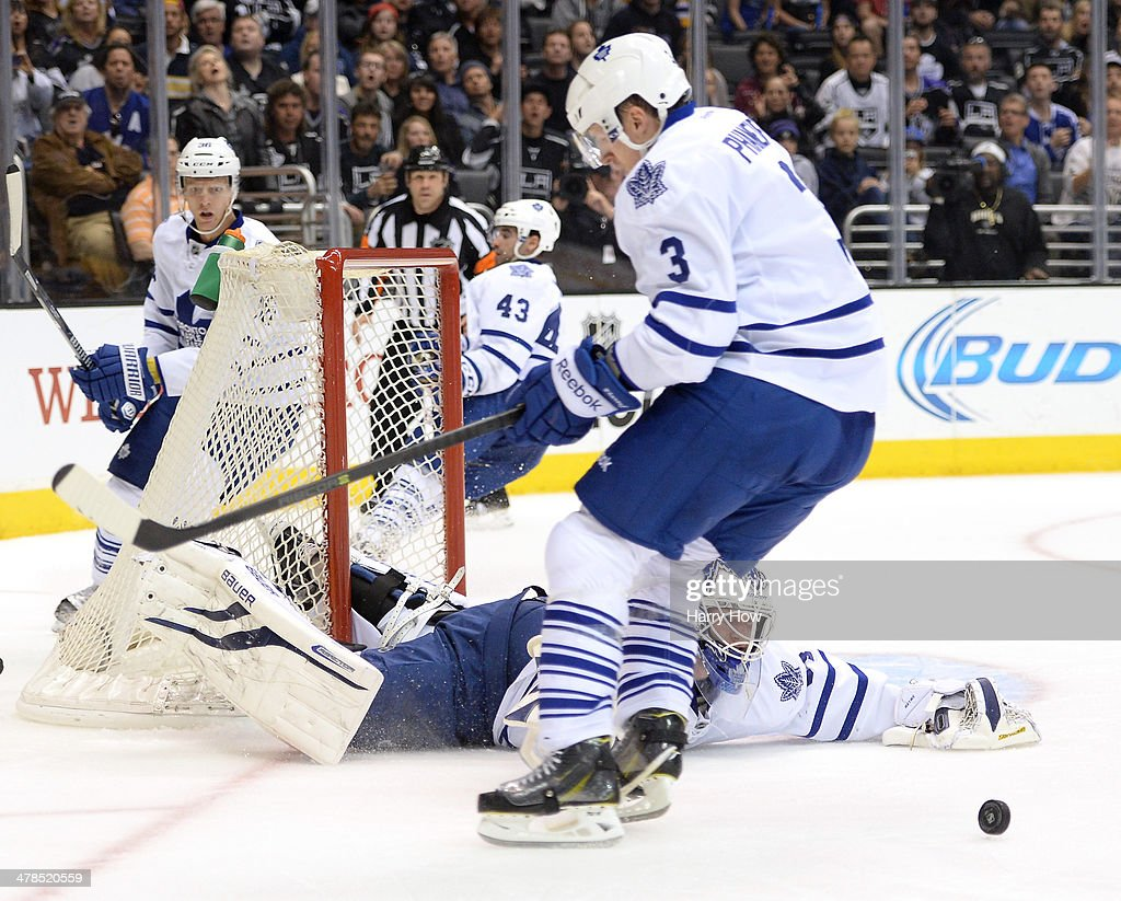 James Reimer #34 of the Toronto Maple Leafs makes scrambles for a rebound with <a gi-track='captionPersonalityLinkClicked' href=/galleries/search?phrase=Dion+Phaneuf&family=editorial&specificpeople=545455 ng-click='$event.stopPropagation()'>Dion Phaneuf</a> #3 after a save on a shot from the Los Angeles Kings during the second period against the Los Angeles Kings at Staples Center on March 13, 2014 in Los Angeles, California.